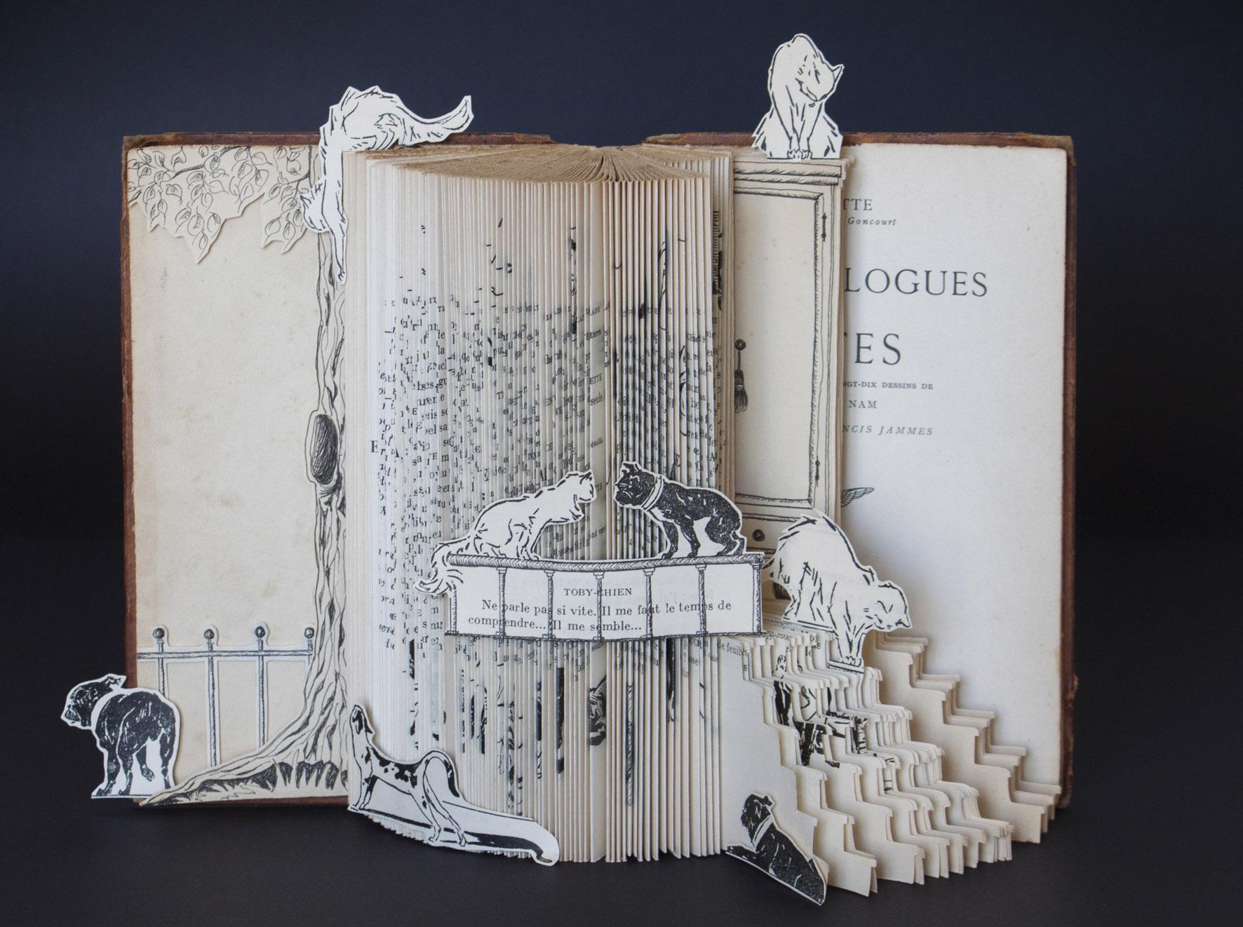 Aquarelas e livros-escultura no Espaço Arte
